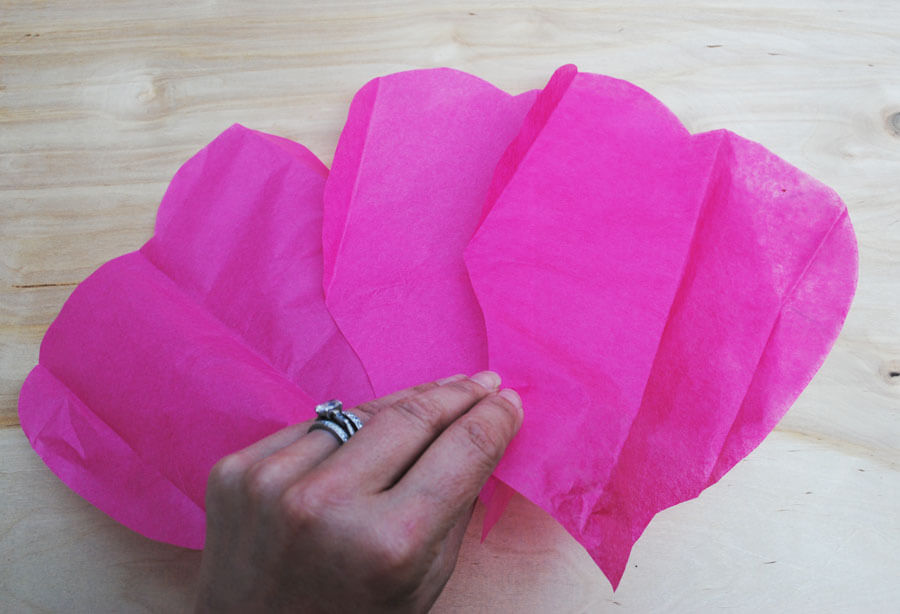 Tips hints giant tissue paper flower tutorial poppartiesink your patterns you will only need about 1 12 packs of tissue per flower i used approximately 4 small 6 medium and 8 10 large petals per flower mightylinksfo
